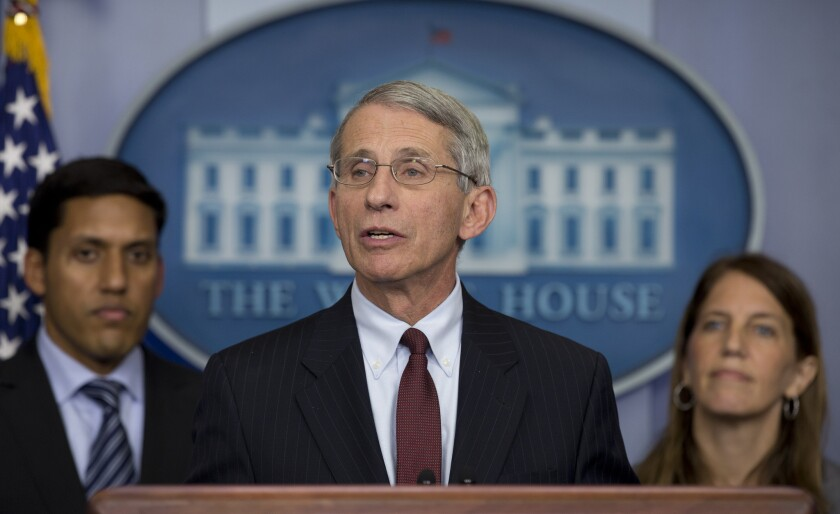 Dr. Anthony Fauci, with officials Raj Shah and Sylvia Burwell, speaks at the White House.
