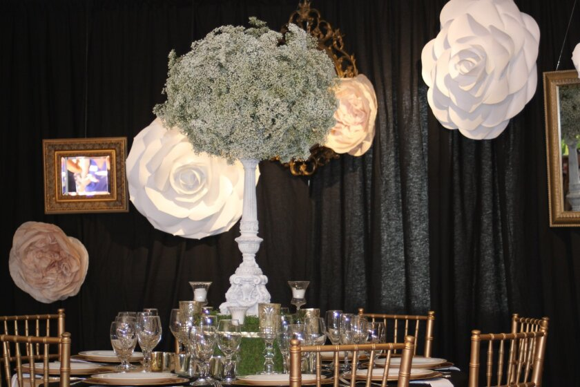 """Table decorations will provide a """"wink and a nod"""" to French architecture and attractions."""