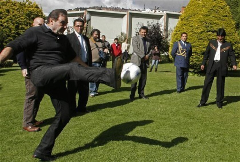 In this photo released by Bolivia's Presidency,  U.S. film director Oliver Stone, left, kicks a ball during a visit to the Bolivia's President Evo Morales, right,  in La Paz, Tuesday, Jan. 13, 2009. (AP Photo/Bolivia's Presidency, Jose Luis Quintana)