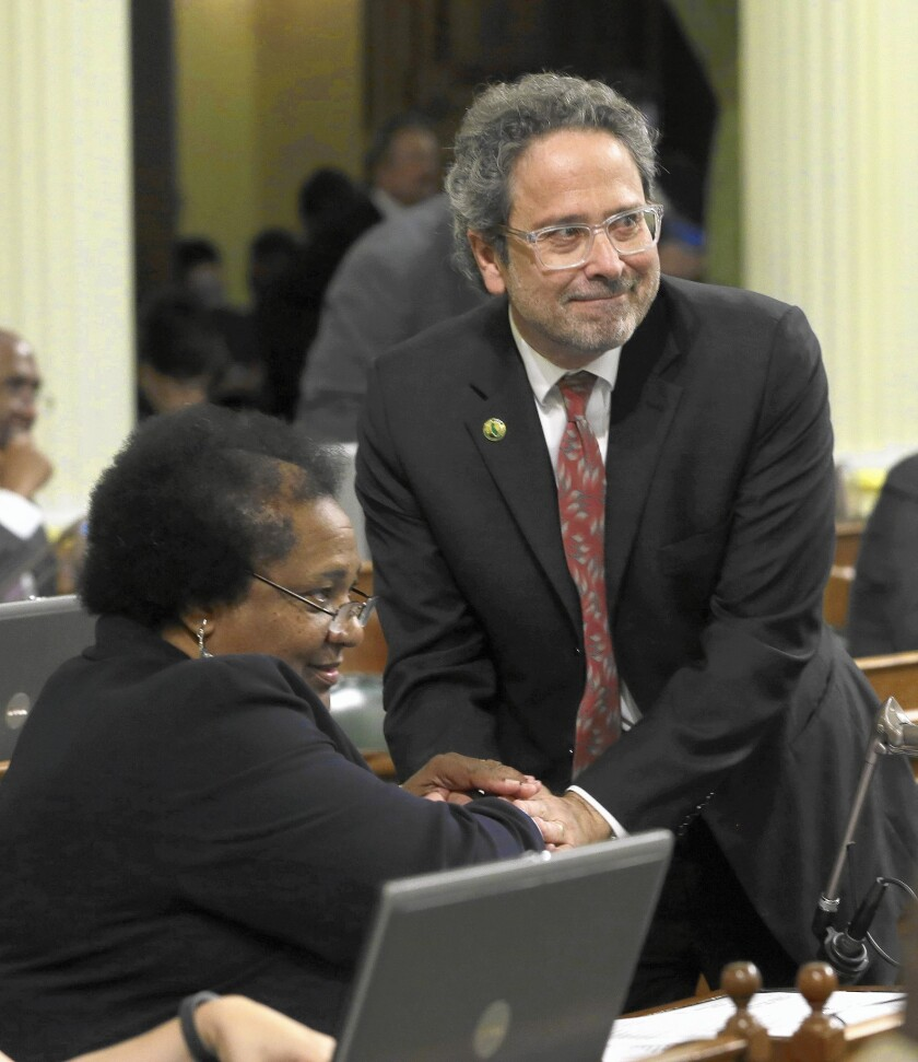 Assemblyman Richard Bloom, right, shown with Assemblywoman Shirley Weber in March, is a co-author of a bill that would increase the $200 filing fee for potential ballot initiatives to $8,000.