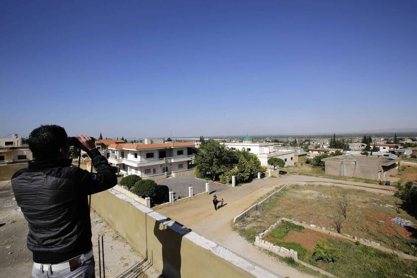 A Lebanese man in the village of Al Qasr looks toward the city of Qusair in neighboring Syria. Rebels in Qusair have threatened to bring the Syrian conflict to the Lebanese border.