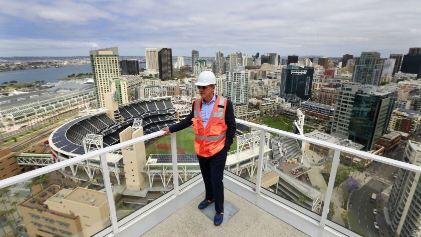 Jerry Brand, senior managing director for Greystar, looks over the 32nd floor deck of Park 12, a luxury apartment building near Petco Park.