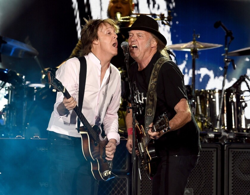 Sir Paul McCartney and Neil Young perform onstage during Desert Trip at the Empire Polo Field on Oct. 8 in Indio. (Kevin Winter / Getty Images)