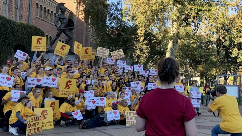 About 150 people gathered Friday to protest the ouster of USC's business school dean, James G. Ellis