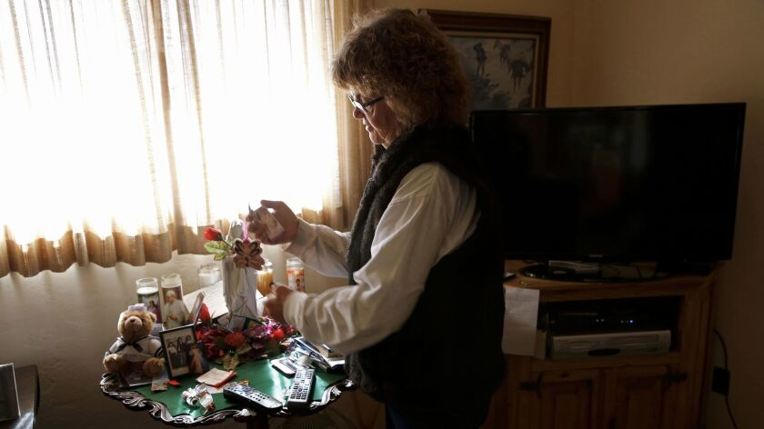 Rancher Sue Krentz keeps a small shrine to her late husband, Rob Krentz.