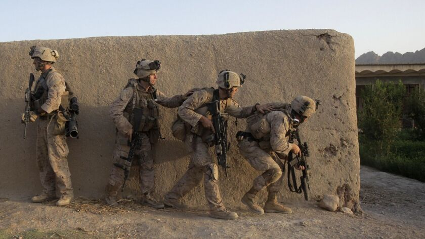 United States Marines from Golf Company, 2nd Battalion, 3rd Regiment, 2nd MEB, move through a compou