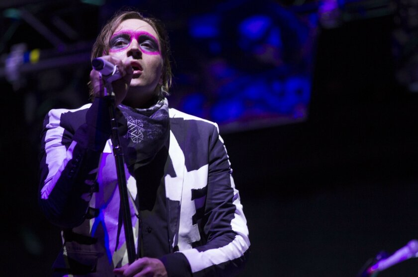 On the third day of the Coachella Valley Music and Arts Festival temperatures dropped as the first weekend wrapped up. Win Butler of Arcade Fire sings to a large crowd on Sunday as they headlined the final day of the first weekend of the festival.
