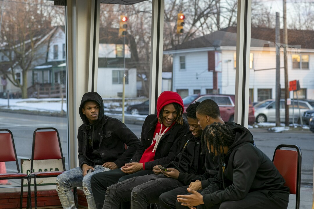 Flint teammates gather at Courtside Cuts the day before the big game against Beecher.