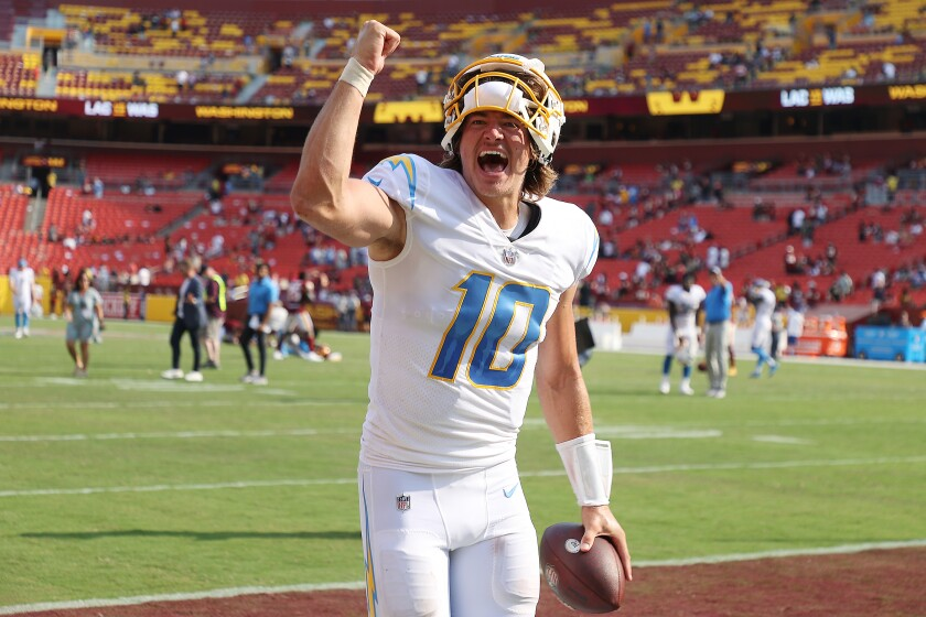 Justin Herbert of the Los Angeles Chargers celebrates after defeating the Washington Football Team on Sunday.