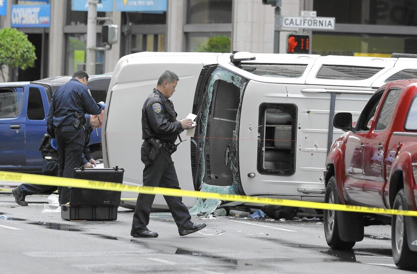 San Francisco police officers investigate the scene where a high-speed car chase ended with a crash and the fatal shooting of a carjacking suspect in September. The city saw an increase in the rates of property and violent crime between 2012 and 2013.