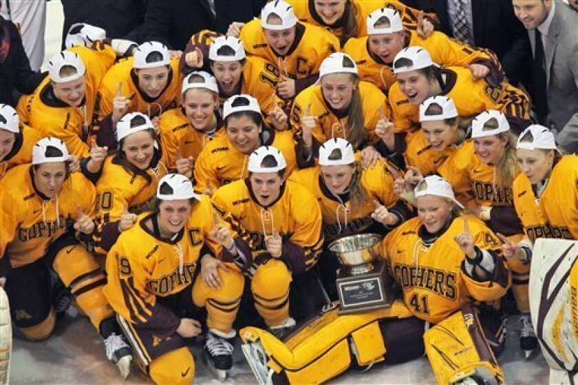 In this March 9, 2013 photo, the Minnesota women's hockey team pose for a photo after winning the WCHA championship game, 2-0, against North Dakota in Minneapolis. Not only has the Minnesota women's hockey team not lost in 46 consecutive games, the Gophers haven't even given up a goal in a month. (