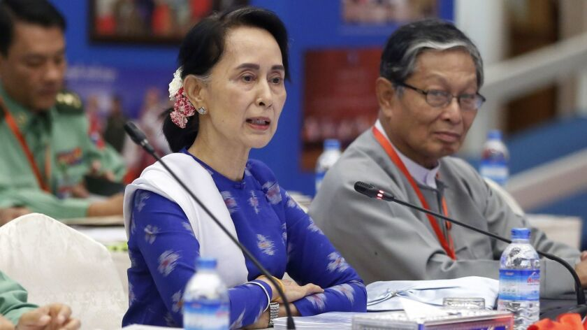 Aung San Suu Kyi, shown Nov. 27, has come under fire for her inaction on Myanmar's brutal violence against its Rohingya minority,