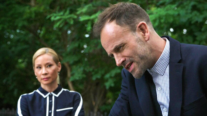 """Lucy Liu and Jonny Lee Miller in a new episode of the mystery series """"Elementary"""" on CBS."""