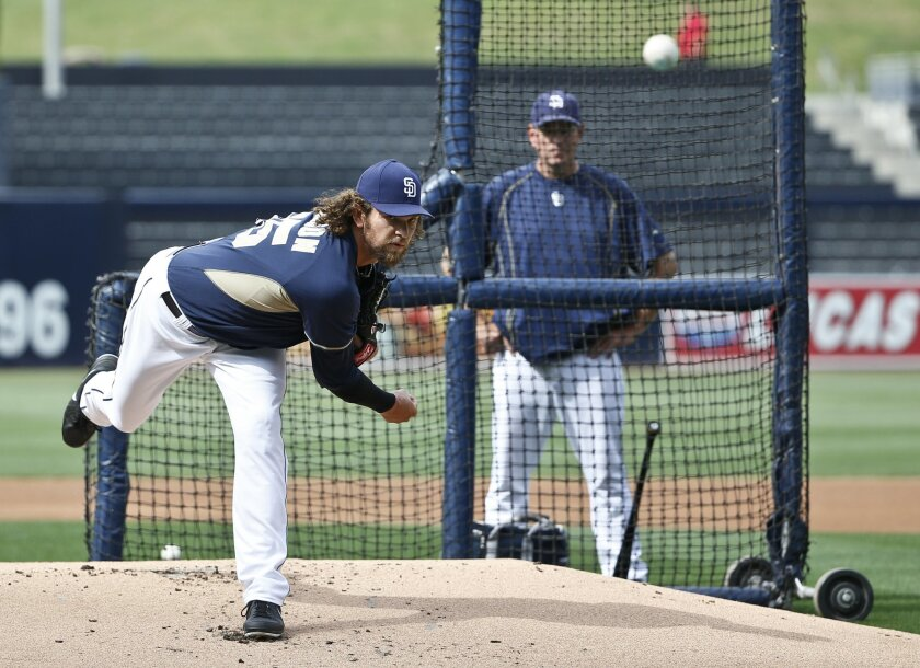 San Diego Padres starting pitcher Josh Johnson, who has spent the entire season on the disabled list, throws a simulated game as pitching coach Darren Balsley watches prior to a baseball game against the Texas Rangers Tuesday, Sept. 1, 2015, in San Diego. (AP Photo/Lenny Ignelzi)