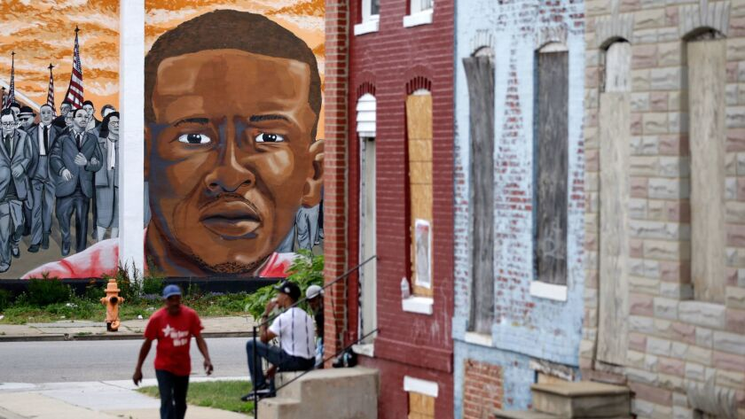 A mural depicting Freddie Gray at the Baltimore intersection where he was arrested in 2015.