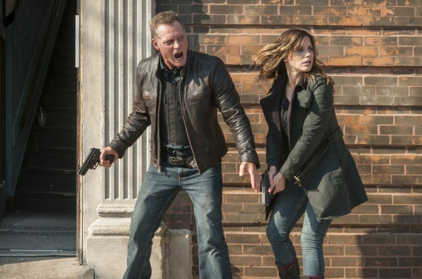 "Jason Beghe and Sophia Bush in NBC's ""Chicago P.D."""