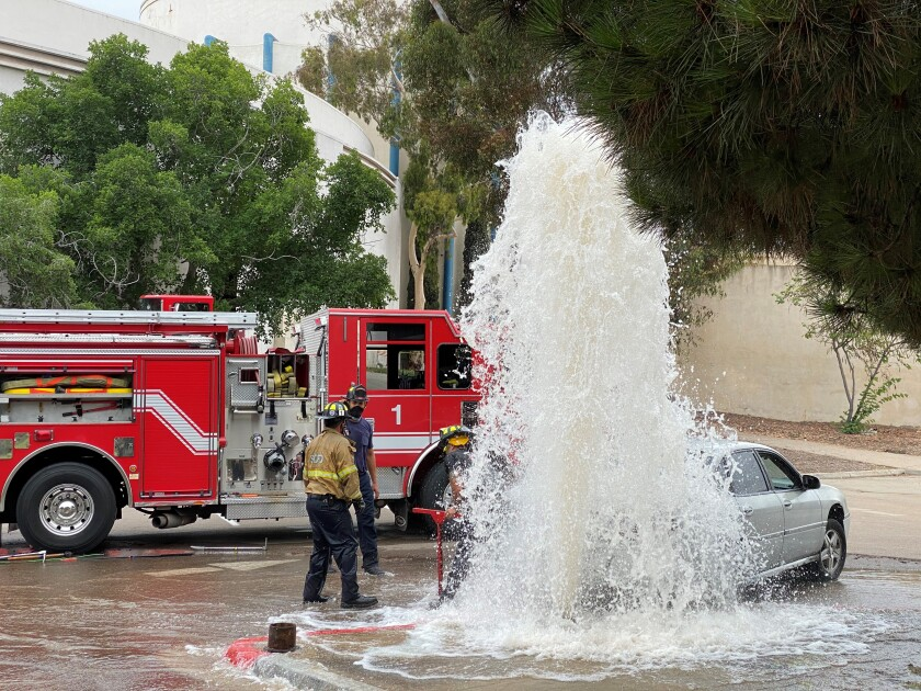 A car sheared off a hydrant and sent water into the basement of the San Diego Air & Space Museum.