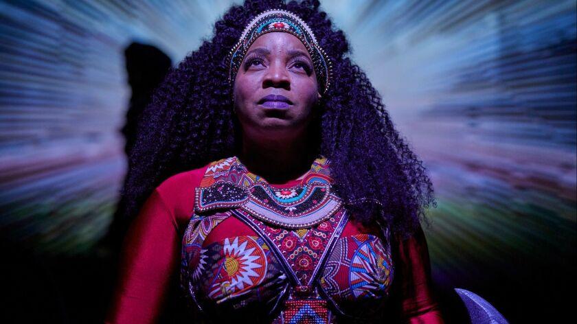 "Kimberly Hébert Gregory in ""Black Super Hero Magic Mama."""