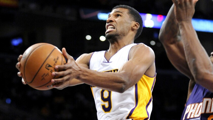 Lakers guard Ronnie Price puts up a shot in a game against Phoenix this season.
