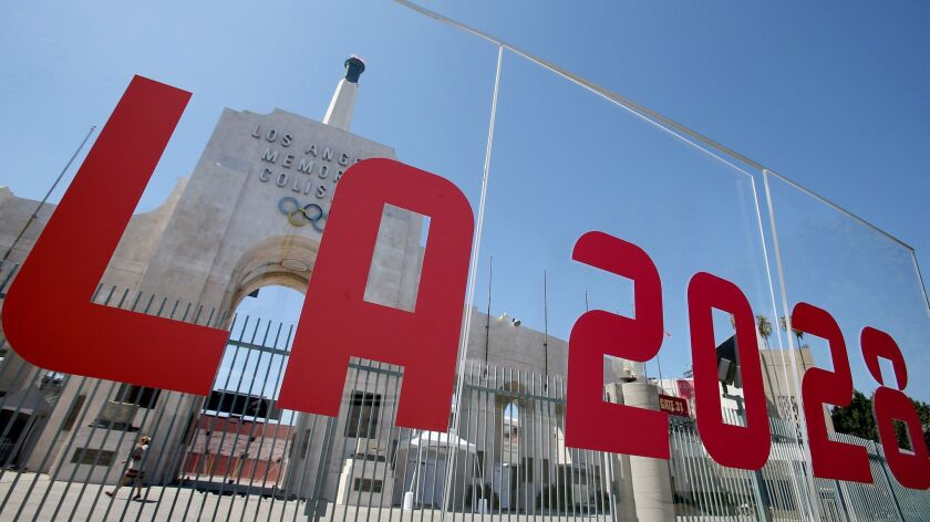 The Coliseum is framed by a plexiglass sign after Los Angeles was awarded the rights to host the 2028 Olympic Games on Sept. 13, 2017.
