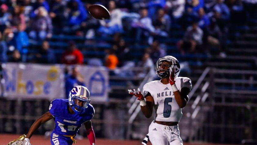 Helix's Isaac Taylor-Stuart intercepts a pass intended for Grossmont's Thomas Mangum.