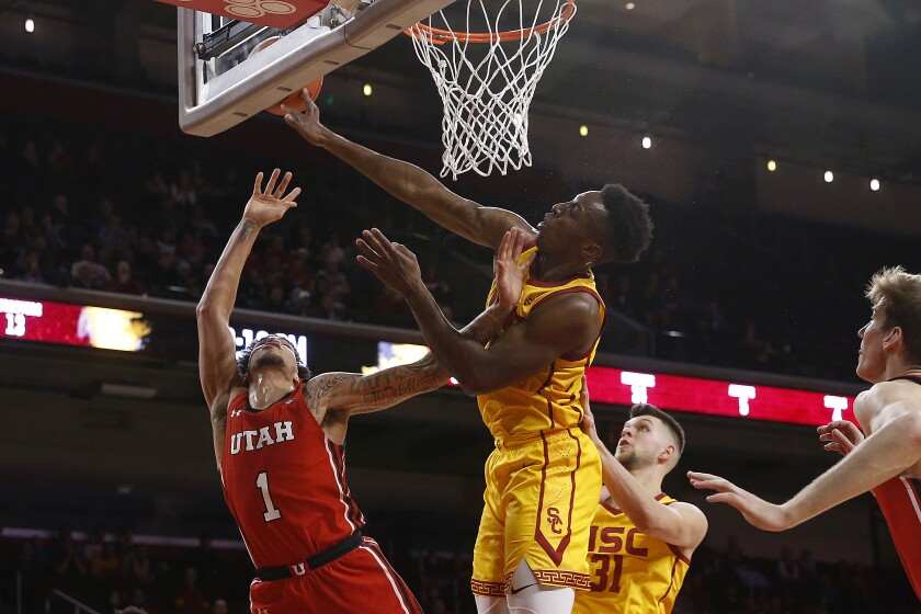 USC center Onyeka Okongwu blocks a shot by Utah forward Timmy Allen during a game Jan. 30 at the Galen Center.