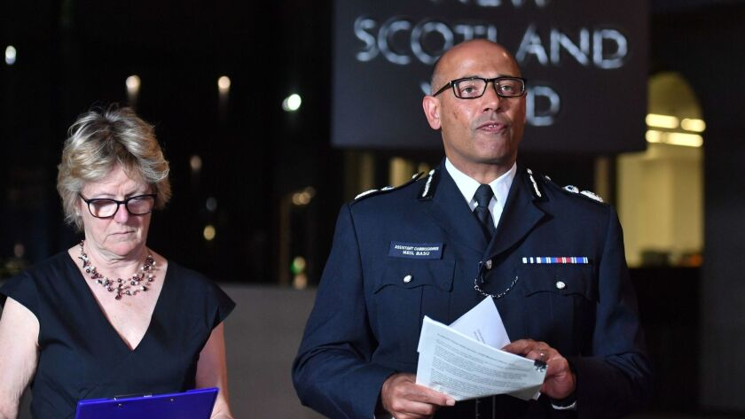 The UK's head of counter-terrorism policing Neil Basu, right, and chief medical officer for England