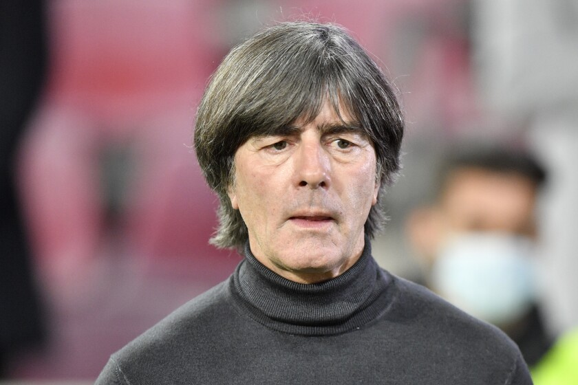 File - In this Wednesday, Oct. 7, 2020 file photo, Germany's head coach Joachim Loew arrives ahead of the international friendly soccer match between Germany and Turkey in Cologne, Germany. The German soccer federation is sticking with Joachim Löw as coach of the national men's team despite poor results including a chastening 6-0 defeat to Spain. (AP Photo/Martin Meissner, file)