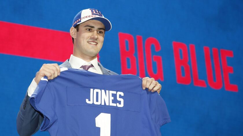 Duke quarterback Daniel Jones poses with his new team jersey after the New York Giants selected Jone