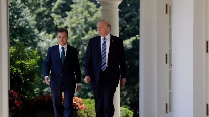 President Trump walks with South Korean President Moon Jae-in to the Rose Garden at the White House.