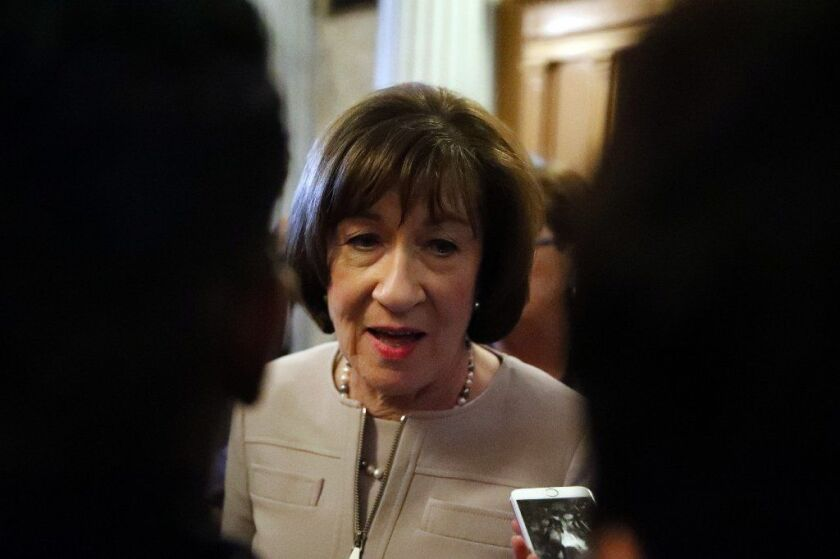 Sen. Susan Collins (R-Maine) talks with reporters after speaking on the Senate floor Friday about her vote on Supreme Court nominee Judge Brett Kavanaugh.