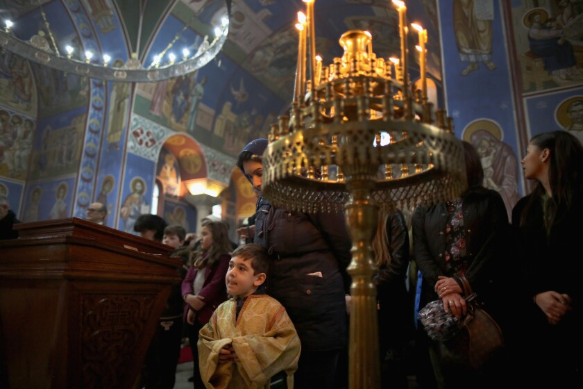 "An altar boy takes part in a service as Serbian Orthodox Christians celebrate the Nativity of Christ liturgy Jan. 7 at Lazarica church in Birmingham, England, a city that a Fox News correspondent said is a ""no-go zone"" for non-Muslims."