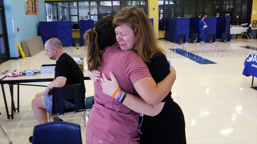 Meredith Swierczynski the mother of Evie Swierczynski receives hugs during the Evie Swierczynski and