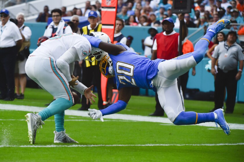 Chargers cornerback Desmond King drags down Miami quarterback Josh Rosen near his goal line.