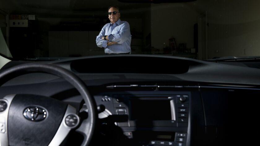 CALABASAS, CA --JULY 02, 2018 --Dennis Dorfman, who put $1,000 down on a Tesla Model 3, before the o