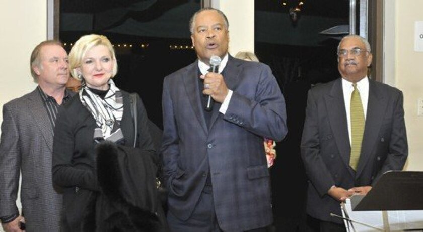 Sempra CEO Jessie K. Knight Jr. addresses the attendees as Owen Perry of Delicias, wife Joye Blount Knight and San Diego Rescue Mission President/CEO Herb Johnson look on.