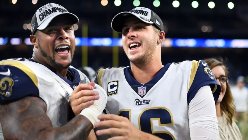 DETROIT, MICHIGAN DECEMBER 2, 2018-Rams gurd Rodger Saffold, left, and qaurterback Jared Goff celebr