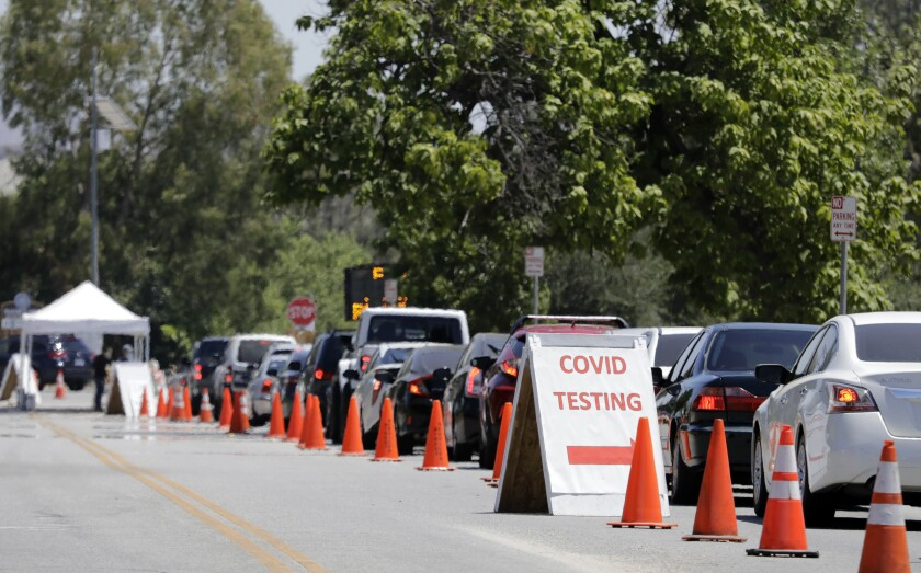 Cars line up to enter the COVID-19 testing site at Hansen Dam Recreation Center