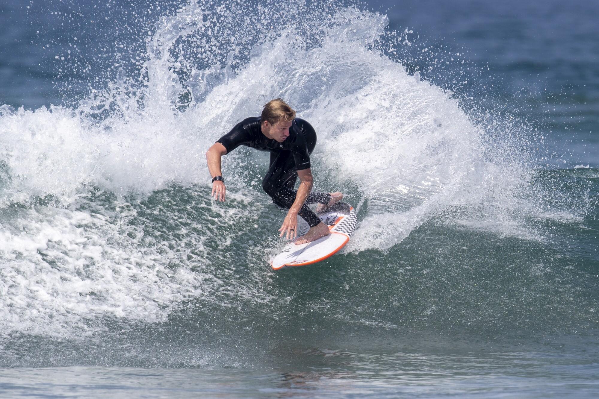 Kolohe Andino maneuvers on a small wave