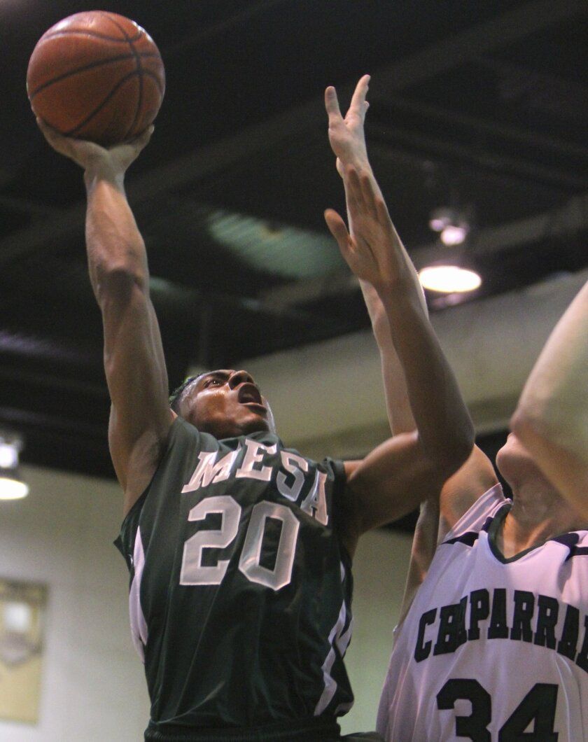 Murrieta Mesa's Shane Staton, guides the ball to the net as Chaparral's Ben Schultz, tries to guard him during their game at Chaparral High Friday night. Murrieta Mesa prevailed 66-49.
