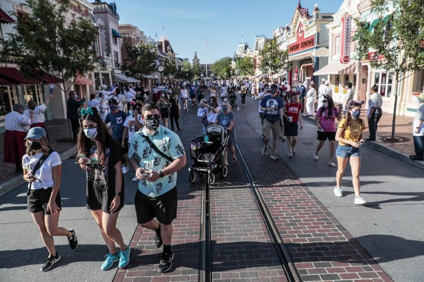 Disney fans stream into Disneyland.