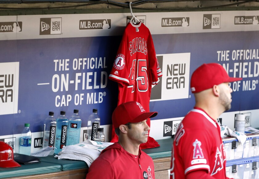 Angels manager Brad Ausmus sits on the bench in front of Tyler Skaggs' jersey during a July 2 game against the Texas Rangers.