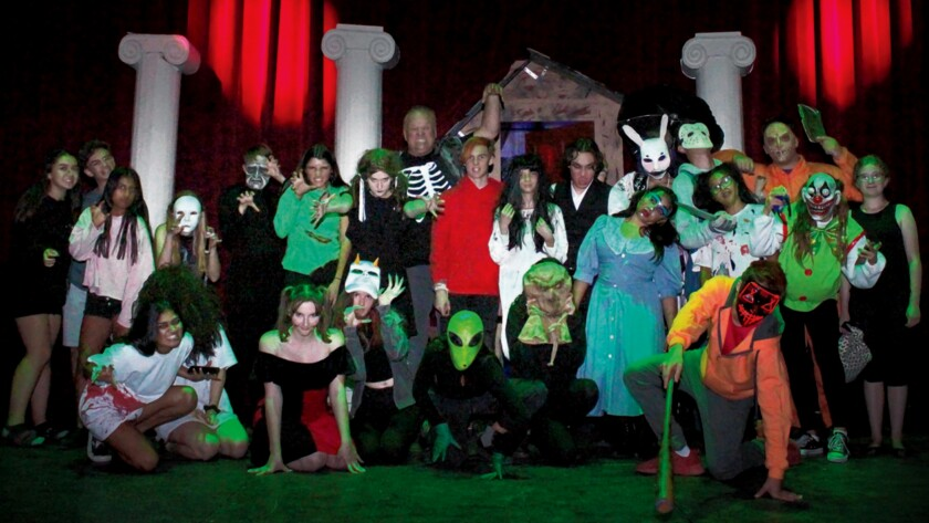 ABSOLUTELY HORRIFYING! La Jolla High School's Theater Arts Department, under the direction of teacher Stacy Allen (standing, center back), presented a Haunted House in the auditorium on 2019 Halloween night. Theater students made the stage a frightening experience for trick-or-treaters looking for something spooky in the neighborhood. — Pearl Preis