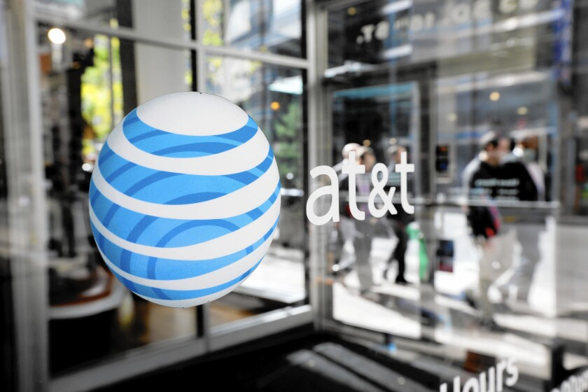 AT&T and other businesses with automated billing systems should flag unusual charges for special attention. Above, an AT&T Wireless store in Philadelphia.
