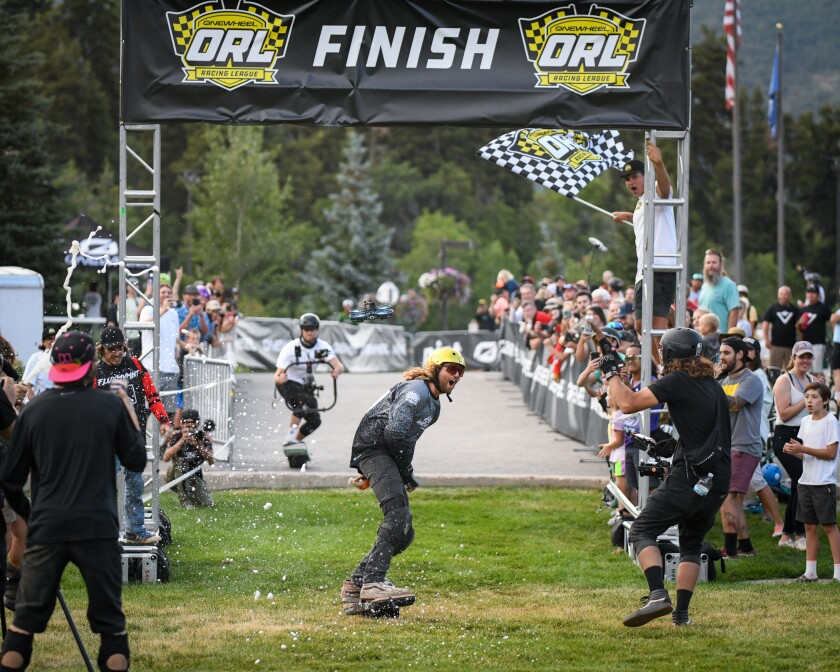 """Tyler James at the finish line of the 2021 edition of """"Race for the Rail."""""""