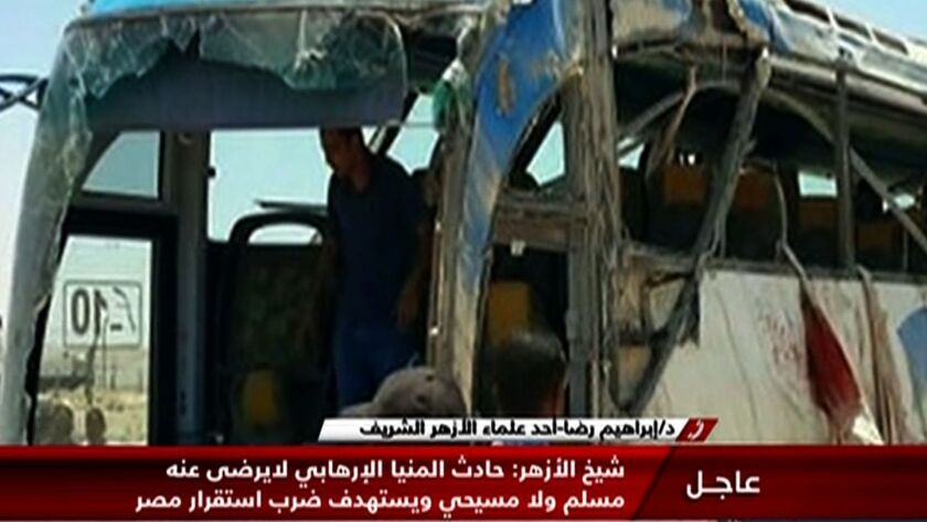 An image grab taken from Egypt's state-run Nile News TV channel on May 26 shows the remains of a bus