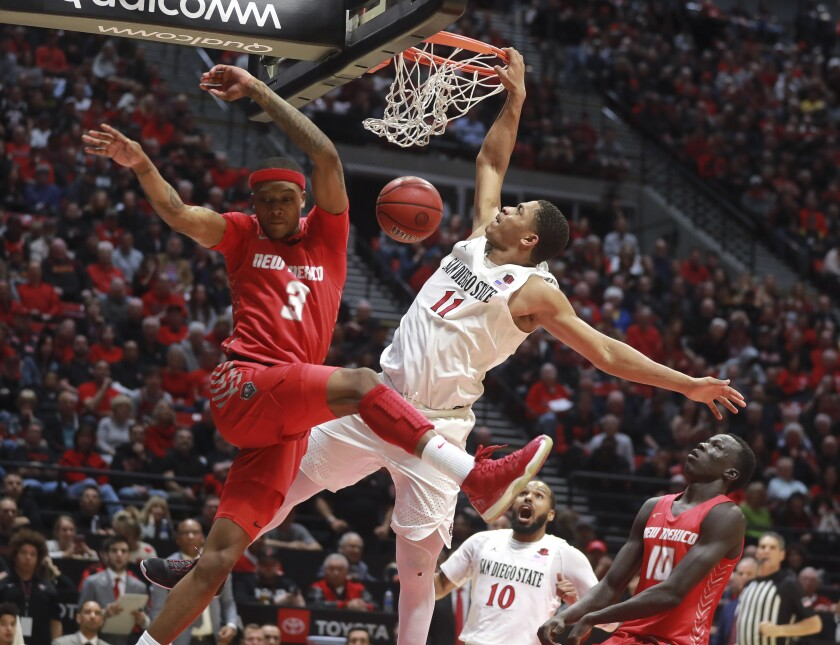 SDSU's Matt Mitchell dunks on New Mexico's Keith McGee during their game at Viejas Arena last season.