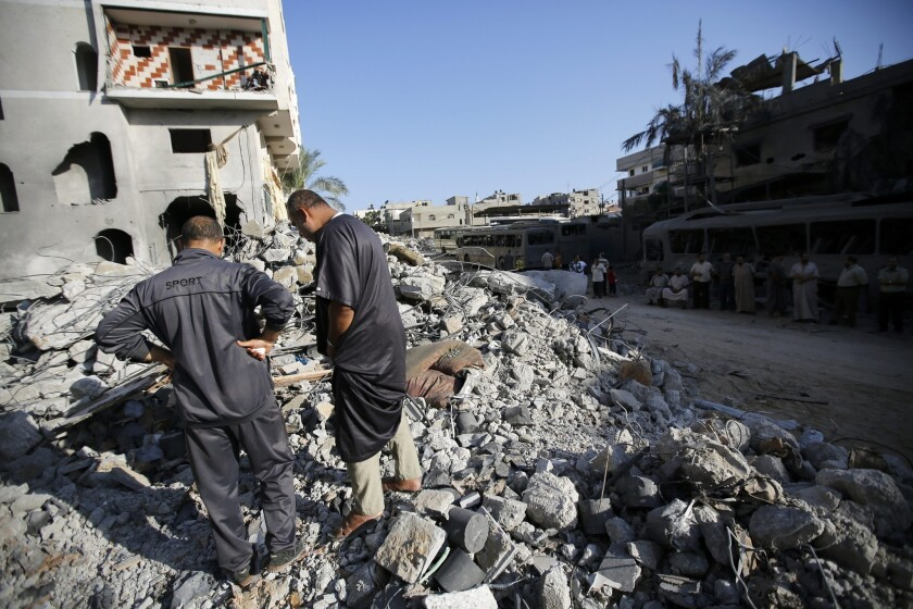 Palestinians inspect the rubble of a destroyed house in Gaza City's Sheikh Radwan neighborhood after an Israeli strike on Aug. 19.