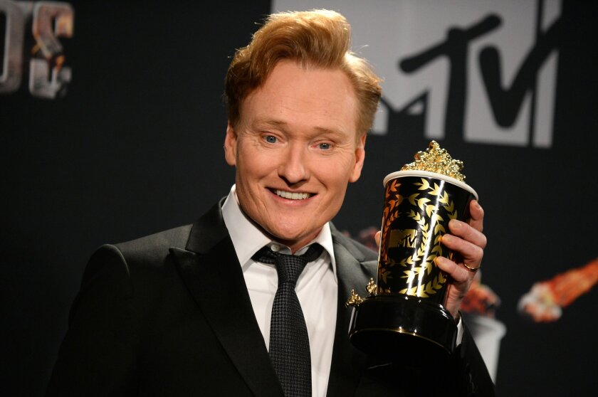 FILE- In this April 13, 2014, file photo, Conan O'Brien poses for a photo in the press room at the MTV Movie Awards at Nokia Theatre in Los Angeles. O'Brien is spending his Presidents Day weekend in Cuba taping segments for an episode of his TNT talk show to air next month, the network said Sunday, Feb. 15, 2015. (Photo by Jordan Strauss/Invision/AP, File)