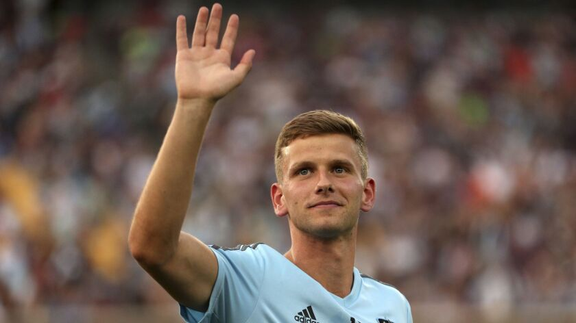 Minnesota United midfielder Collin Martin, who came out publicly as gay earlier in the day, waves to